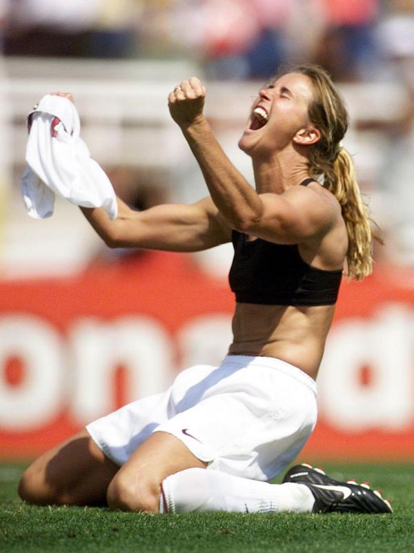 Brandi Chastain celebrates after kicking the winning penalty shot to win the 1999 Women's World Cup final at the Rose Bowl in Pasadena, Calif., in 1999.