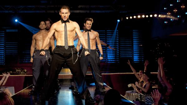 Mike (Channing Tatum, center) strips down in Steven Soderbergh's latest, <em>Magic Mike --</em> and reveals some previously unseen acting chops.