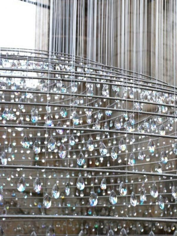 "According to the artists' <a href=""http://www.caoperrotstudio.com/en/portfolio/beauvaiscollegiale.html"" target=""_blank"">website</a>, the crystals that hang in the tower are meant to serve as symbols of the soul's purification by ascension to heaven."