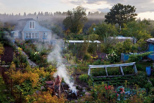 """At his dacha, Sergey Yudin plants, burns weeds and indulges the """"inner peasant"""" who lives within many Russians. In pinched Soviet times, such gardens grew some 90 percent of Russia's vegetables."""