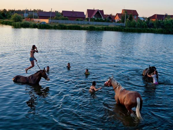 Summer, the short, sweet release from the interminable cocoon of Russian winter, is a time for swimming and riding, and sometimes both.