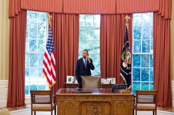 "President Barack Obama talks on the phone with Solicitor General Donald Verrilli in the Oval Office, after learning of the Supreme Court's ruling on the ""Patient Protection and Affordable Care Act,"" on Thursday."