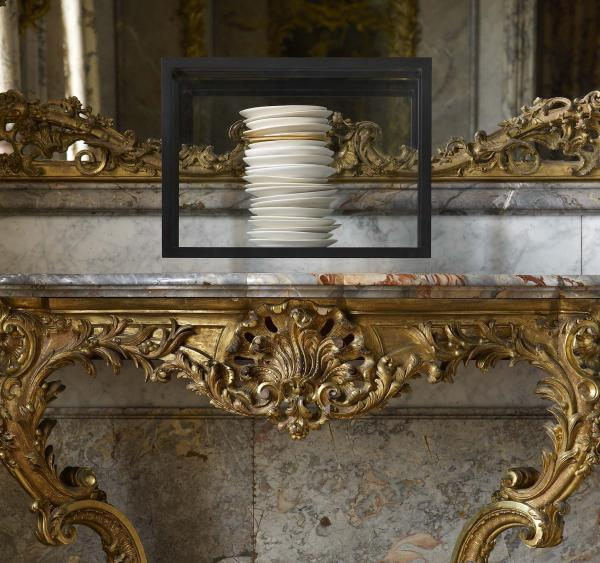 De Waal's 2012 work <em>all and more</em> is on display in the Dining Room. It is made up of 23 porcelain dishes: 22 in white and cream glazes and one gilded dish, contained in a clear glass vitrine.