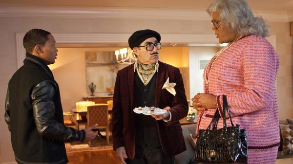In <em>Madea's Witness Protection</em>, George Needleman (Eugene Levy, center) is put in witness protection with Madea (Tyler Perry, right) after he discovers he's the fall man for a Ponzi scheme.
