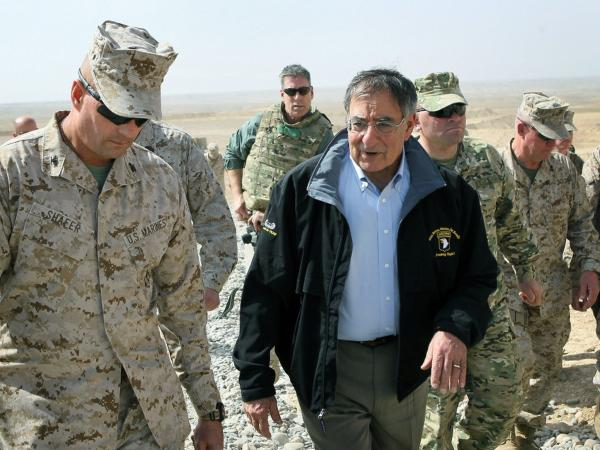 U.S. Secretary of Defense Leon Panetta, center, is greeted by Col. John Shafer, left, with RTC 6 Wednesday at Foward Operating Base Shukvani, Afghanistan. As Panetta was landing at another base, an Afghan drove a truck onto the airfield until it crashed and exploded.
