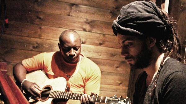 Vieux Farka Toure (left) and Idan Raichel, collaborating as The Toure-Raichel Collective, released <em>The Tel-Aviv Session </em>on March 26.