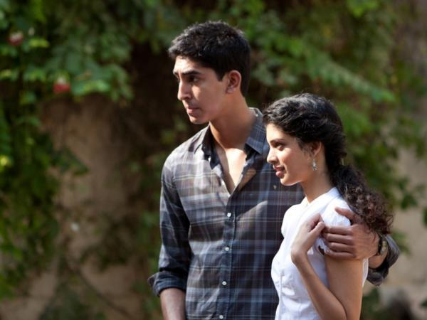 Dev Patel as Sonny and Tena Desae as Sunaina on the set of <em>The Best Exotic Marigold Hotel. </em>