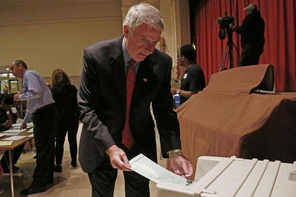 Barrett puts his ballot into a machine after voting in Milwaukee.