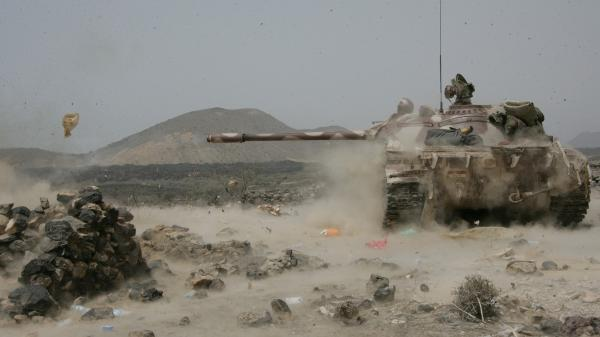 A Yemeni army tank fires at positions of al-Qaida militants near the coastal town of Shaqra, Yemen, last week, in a photo provided by Yemen's Defense Ministry. Yemen's army says it has pushed al-Qaida fighters out of towns in the south.