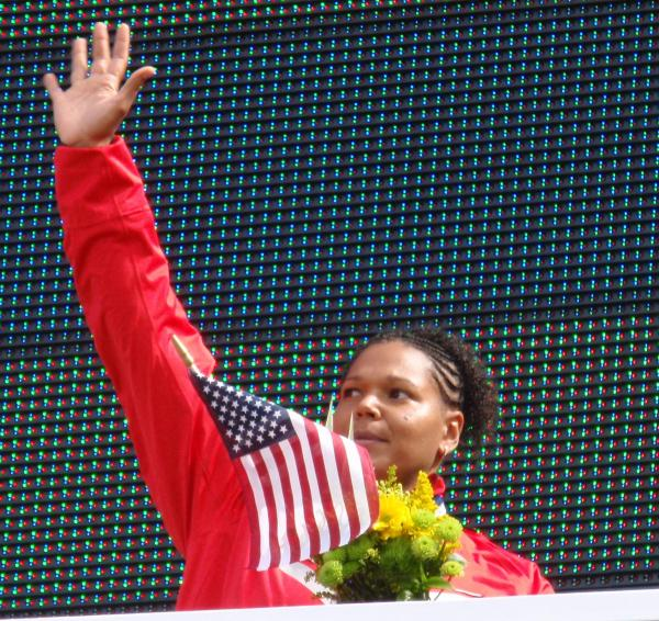 By Tom Banse Caption: Former UW Husky and Renton High School grad Aretha (Hill) Thurmond is headed to her fourth Olympics.