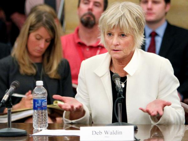 Deb Waldin testifies about her experience with a debt collector at a Minnesota hospital during a hearing led by Sen. Al Franken in St. Paul, Minn., in late May.
