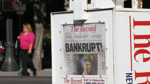 A headline in <em>The Record</em> newspaper in Stockton, Cailf., tells the story of the city's plan for operating under Chapter 9 bankruptcy protection following failed talks with bondholders and labor unions.