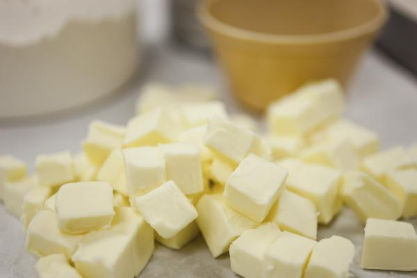 Cut the butter into one-half inch chunks. Add water and mix by hand.