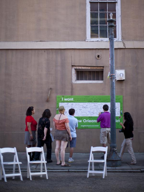 Festival-goers at the Jammin' on Julia street fair in New Orleans interact with Neighborland's art installation on the side of an empty building in the city's arts district in April.
