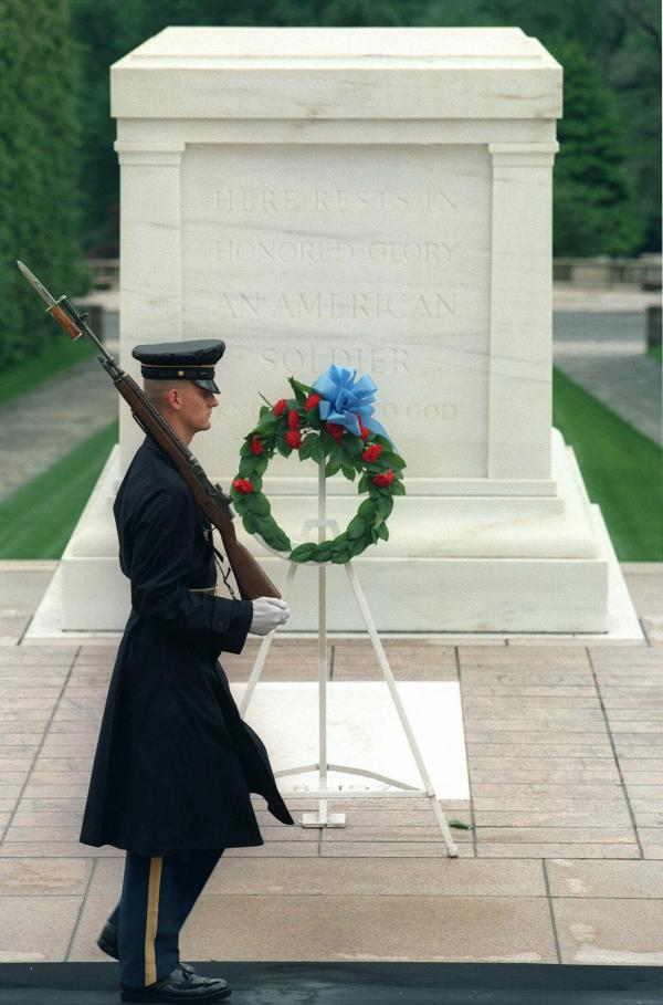 A sentinel walks post at the Tomb of the Unknowns at Arlington National Cemetery, another of the monumental backdrops in Lawson's crime novels.
