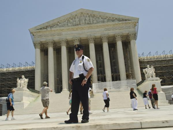 A Supreme Court Police officer stands outside the U.S. Supreme Court on June 28, 2012 in Washington, D.C.