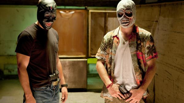 In <em>Savages, </em>two drug dealers — Chon (Taylor Kitsch, left), a former Navy SEAL, and Ben (Aaron Johnson), a pacifist — are forced to take up arms when they anger the head of a Mexican cartel.