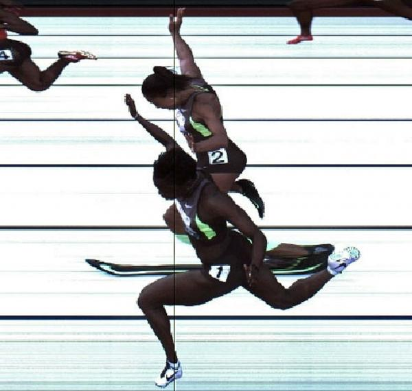 In this handout photo provided by the USATF, Jeneba Tarmoh (bottom, lane 1) and Allyson Felix cross the finish line at exactly the same time in the women's 100 meter dash final during Day Two of the 2012 U.S. Olympic Track & Field Team Trials at Hayward Field on June 23 in Eugene, Ore. It's their torsos, not head, hands, feet or arms, that matter.