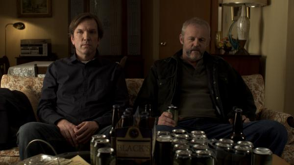 Robert (Martin Donovan, left), a writer in need of inspiration, sits with his uncultured kidnapper, Gus (David Morse), in <em>Collaborator</em>. Donovan also wrote and directed the film.