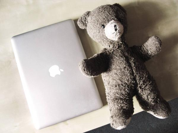 "Michelle Ashton, 27, London, Web designer: ""MacBook Pro. It's uninsured and full of work and personal photographs. Twenty-seven-year-old teddy bear, 'Teddy,' who has already survived one burning house."""