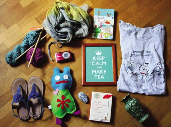 """Cristina Cavallari, 43, Italy, crafter/graphic designer: """"My family cat (not pictured), wool and wood knitting needles ... my best t-shirt, blue comfortable sandals ... felt monster I made, sea rock from my father ... old German vase."""""""