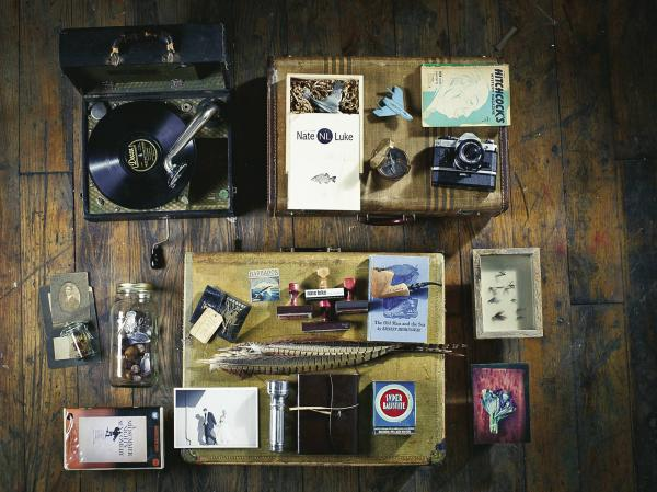 """Nate Luke, 36, Springfield, Mo., advertising photographer. """"Portable phonograph I used to court my wife. ... First camera given to me by my dad. ... Thai red-pepper seeds ... Shadow box of old dry flies ... Wedding photo with my wife ... Can of gun powder from my Grandfather."""""""