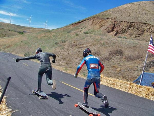 Patrick Switzer, in the blue leather outfit on the right, is one of the top downhill skateboarders in the world. He won the race at the recent Maryhill Festival of Speed. Photo by Anna King