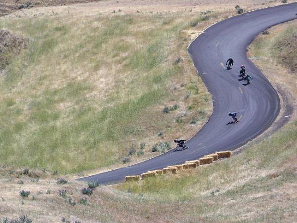 Nearly 300 men and 11 women showed up to skate Maryhill Loop Road near Goldendale, Washington recently. The skaters can reach speeds of about 50 miles per hour down the road's 22 curves. Photo by Anna King