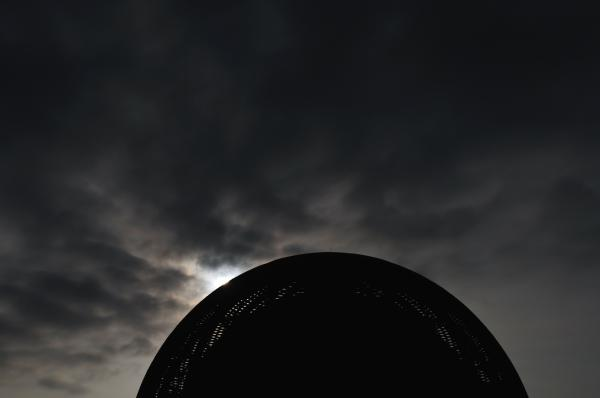 """A new day dawning on humanity: the sun rises behind <a href=""""http://public.web.cern.ch/public/en/spotlight/SpotlightGlobe-en.html"""">The Globe of Science and Innovation</a> at CERN on July 4, 2012."""