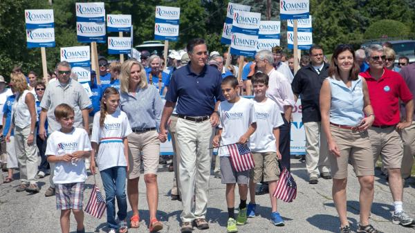 Republican presidential candidate Mitt Romney walks with his wife, Ann, and other family members, along with Republican Sen. Kelly Ayotte, in the Wolfeboro, N.H., Independence Day parade Wednesday. Ayotte has been mentioned as a possible vice presidential contender.