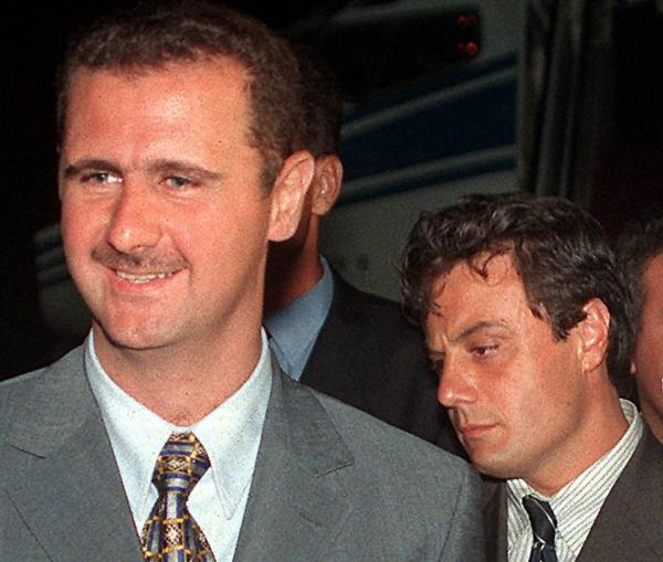Then-Col. Bashar Assad (left) and Manaf Tlass in 1999. Tlass, now a brigadier general, has reportedly defected and is headed to France.