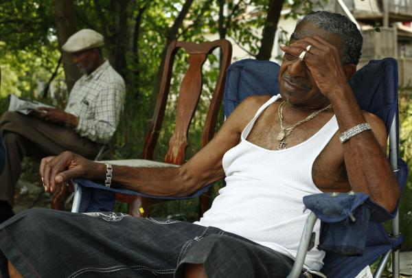 """Papa B"" (left) and ""Cadillac Bob"" find refuge from the heat in a shaded lot between their homes on Chicago's South Side."