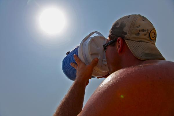 John Rohlfing, 38, takes a drink as he works on the construction of his new home Thursday in North Aurora, Ill. He started at 6:00 a.m. and quit at 11:00 a.m. because of triple-digit temperatures.