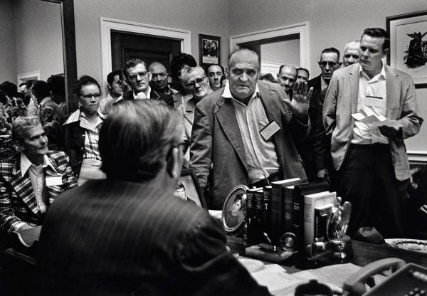 Disabled coal miners and widows confront their Kentucky congressman's poor record of supporting black lung legislation in Washington, D.C., in 1975.