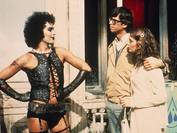 Tim Curry in <em>The Rocky Horror Picture Show</em> with Barry Bostwick and Susan Sarandon in 1975.