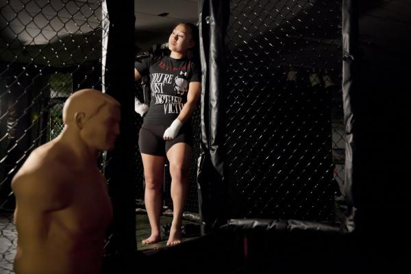 """Lylna Thao thought she could handle a traditional Hmong marriage, which is what her Laotian family expected of her. But once she was wed, her new life felt claustrophobic. She secretly began to take boxing classes, then got divorced, despite the scandal it caused in the Hmong community. She began fighting as a women's mixed martial artist. """"I love life,"""" she says now."""