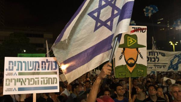 Israeli reservists soldiers and Israeli parents whose children were killed during army service attend a rally in support of a new law to mandate universal military conscription — including ultra-religious Jews who had been previously exempt and Arab Israelis, July 7, in Tel Aviv, Israel.