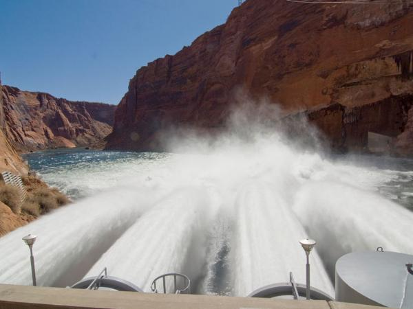 Power companies say the last high flow through the Glen Canyon Dam, in 2008, cost almost $4 million in lost revenue.
