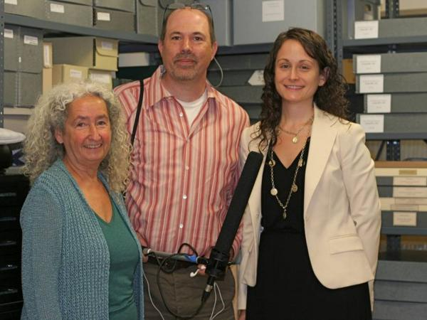 Reporter Bradley Klein stands with Nora Guthrie (left), director of the Woody Guthrie Foundation, and archivist Tiffany Colannino (right).