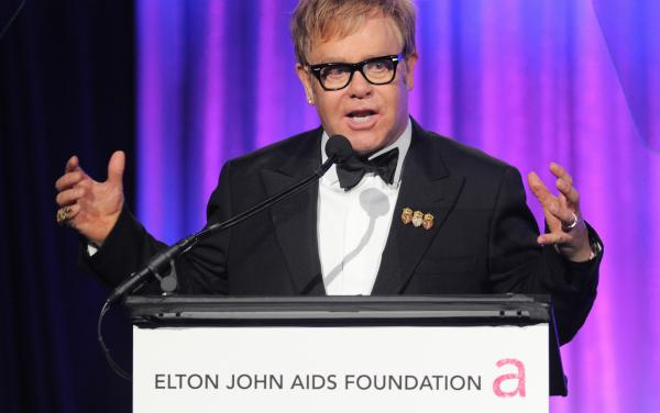Sir Elton John speaks at an Elton John AIDS Foundation benefit in 2010. The organization, which John founded in 1992, provides grants to support HIV and AIDS prevention and treatment programs.