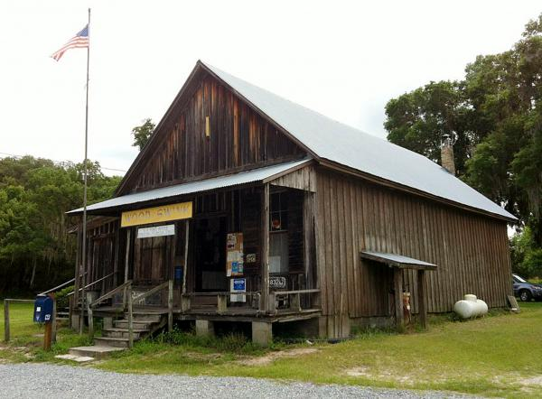 "The Wood & Swink general store sits near the crossroads of two county roads. Wilma Sue Wood, who was Evinston's postmaster for 32 years, says the town's 150 or so residents visit to hear news: ""Who's had a baby; who's died."""