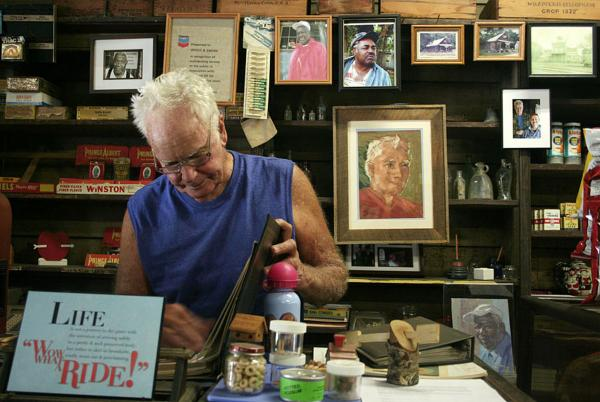 Freddie Wood stands at the counter of the Wood & Swink general store in Evinston, Fla.