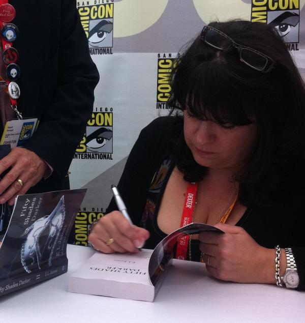 E.L. James signs copies of her book <em>Fifty Shades of Grey</em> at Comic-Con in San Diego on Thursday.