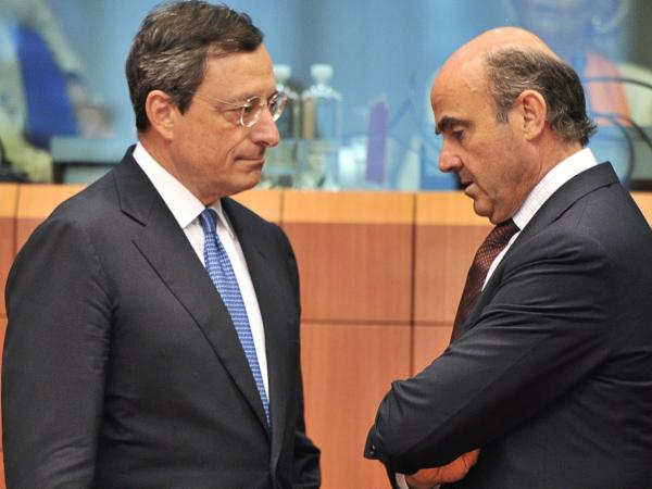 European Central Bank president Mario Draghi, left, speaks with Spanish Finance Minister Luis De Guindos on Monday. The ECB has increased its influence over European countries struggling with debt.