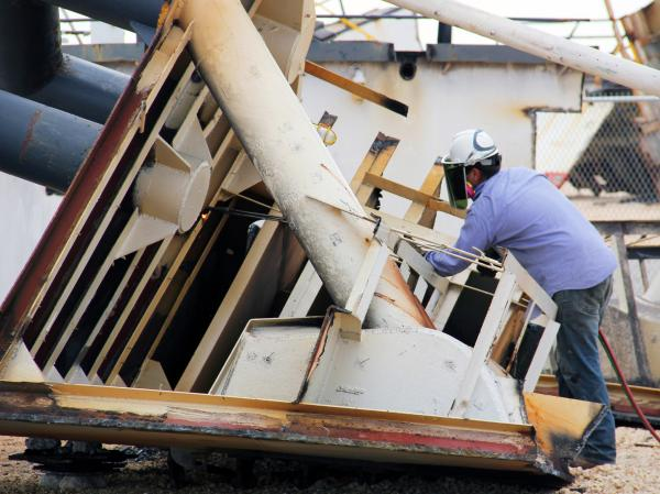 A ship cutter helps dismantle a ship at the Bay Bridge Texas recycling yard.