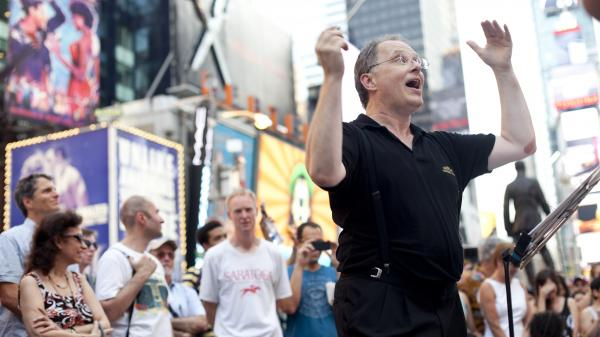 Conductor Kent Tritle in Times Square. (And that's WNYC's John Schaefer in the Saratoga T-shirt.)