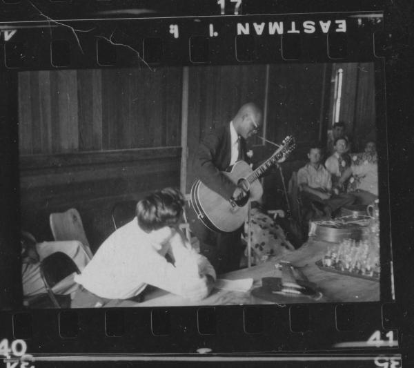 Alan Lomax watches Rev. Gary Davis