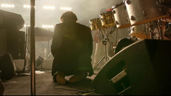 James Murphy, frontman for the now-disbanded LCD Soundsystem, kneels on the Madison Square Garden stage. <em>Shut Up and Play the Hits</em> documents the band's final show at the landmark New York venue.