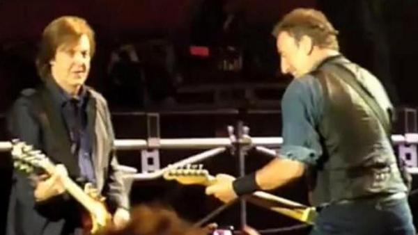 "Paul McCartney, left, and Bruce Springsteen during Saturday's show in Hyde Park — before the plug was pulled. Frame grab from video posted by ""BenR753"" on YouTube."