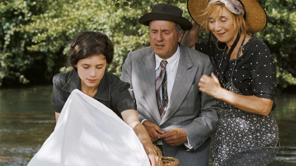 <em></em> Pascale (Daniel Auteuil) with his sister Nathalie (Marie-Anne Chazel, right) and daughter Patricia (Astrid Berges-Frisbey), who, to his dismay, becomes pregnant in <em>The Well-Digger's Daughter</em>. The film is a remake of Marcel Pagnol's 1940 movie.